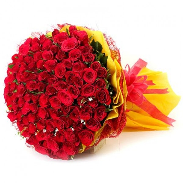 100 Red Roses In Yellow Paper Wrapping